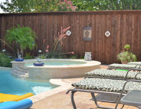 pool and hottub with privacy fence